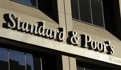 FILE - This Oct. 9, 2011 file photo shows 55 Water Street, home of Standard & Poor's, in New York. S&P said Monday, Feb. 4, 2013, the U.S. government is expected to file civil charges against Standard & Poor's Ratings Services, alleging that it improperly gave high ratings to mortgage debt that later plunged in value and helped fuel the 2008 financial crisis. The charges would mark the first enforcement action the government has taken against a major rating agency involving the worst financial crisis since the Great Depression. (AP Photo/Henny Ray Abrams, File)