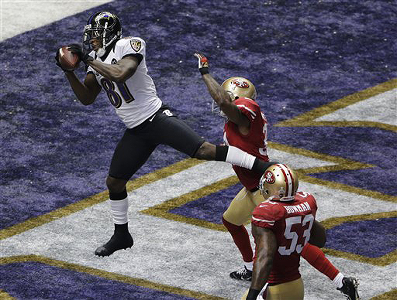 Baltimore Ravens wide receiver Anquan Boldin (81) catches a 13-yard pass for a touchdown as San Francisco 49ers linebacker NaVorro Bowman (53) trails the play during the first quarter of Super Bowl XLVII on Sunday. The game is being played in New Orleans.