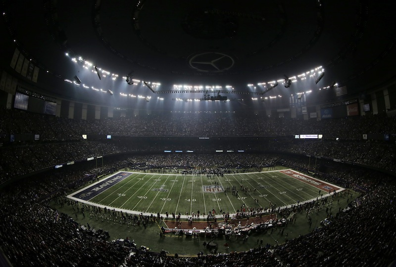 Fans and members of the Baltimore Ravens and San Francisco 49ers wait for power to return in the Superdome during an outage in the second half of the NFL Super Bowl XLVII football game on Sunday.
