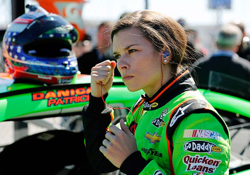 Danica Patrick removes her earplugs after qualifying for the Daytona 500 race Sunday.