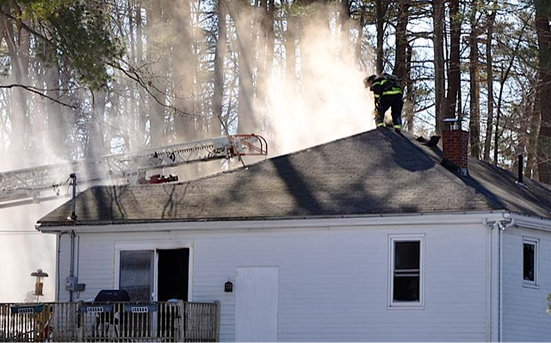 Firefighters from Portland put out a blaze in North Deering on Sunday afternoon. A woman in her 50s was badly burned and taken to the hospital.