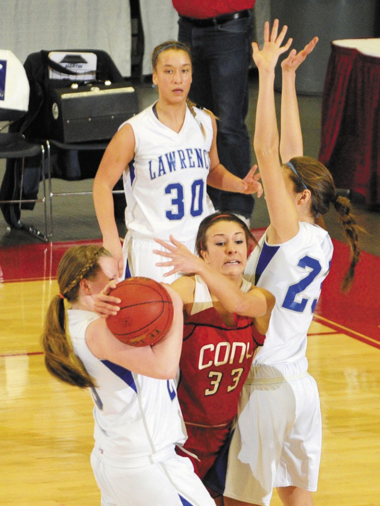 Cony senior guard Josie Lee gets double teamed by Lawrence's Jordyn Towers, left, and Paige Belanger during Cony's 49-37 win in an Eastern Class A semifinal Wednesday at the Augusta Civic Center.