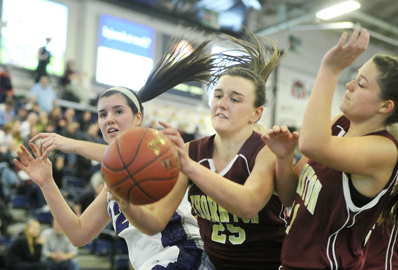 Olivia Shaw of Thornton Academy gains inside position Monday to haul down a rebound in front of Chelsea Saucier of Deering at the Expo.