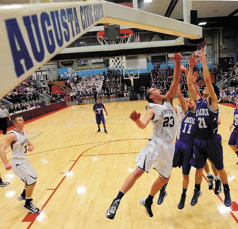 Nick Noiles battle for rebound during the Eastern Class A championship game Friday at the Augusta Civic Center. Hampden, the No. 1 seed, made a desperation 3-pointer at the buzzer to beat the Bulldogs, 40-39.