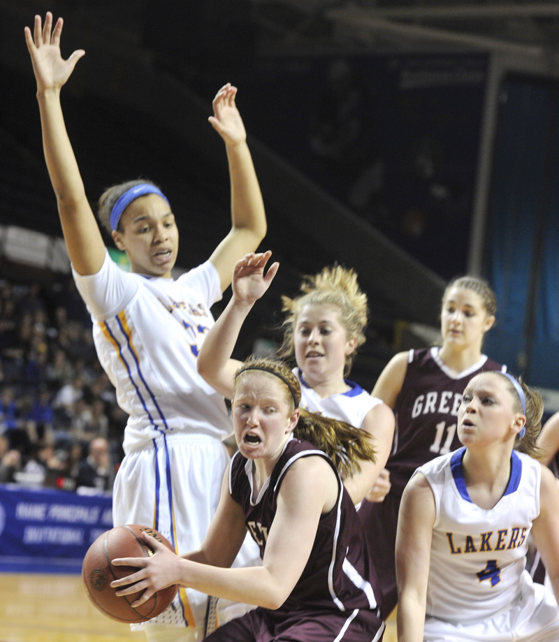 Haley Felkel of Greely is surrounded by Lake Region defenders after coming up with a rebound Thursday in a Western Class B girls' basketball semifinal at the Cumberland County Civic Center. Lake Region, the No. 1 seed, won 42-27.