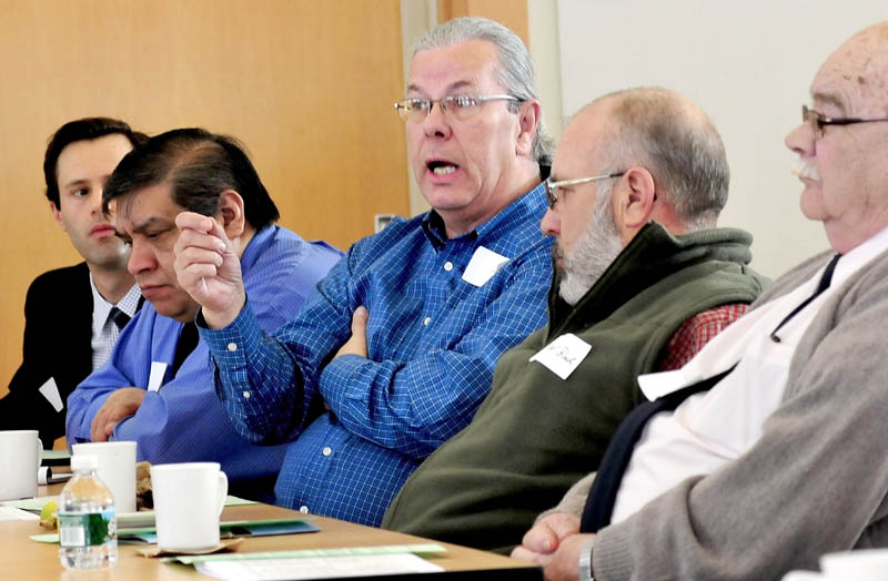 Gary McGrane, a Franklin County Commissioner, makes a point in reaction to measures to reduce expenses offered by Franklin Memorial Hospital/ Franklin Community Health Network President and CEO Rebecca Ryder on Wednesday.