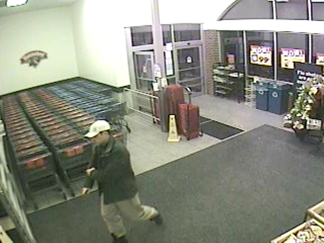 This surveillance image shows a man police believe was an accomplice who helped surveil the store before the burglary.
