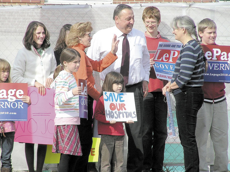 Paul LePage, then the Republican nominee for governor, talks to supporters in front of Central Maine Medical Center on Oct. 14, 2010, at a rally to decry the state's debt to Maine's hospitals. As governor, he has delivered on the debt payment that he promoted at the rally, named an industry lobbyist to a Cabinet post and called for another debt payment.
