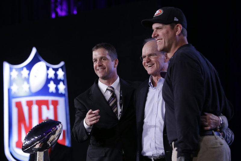 Baltimore Coach John Harbaugh, left, and San Francisco Coach Jim Harbaugh, right, pose with their father, former college coach Jack Harbaugh, during a news conference in New Orleans Friday.