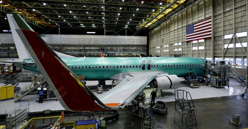 A Boeing Co. next-generation 737 airplane sits nearly completed at the end of Boeing's 737 assembly facility in Renton, Wash., which cranks out more than one of the widely used airplanes every day.