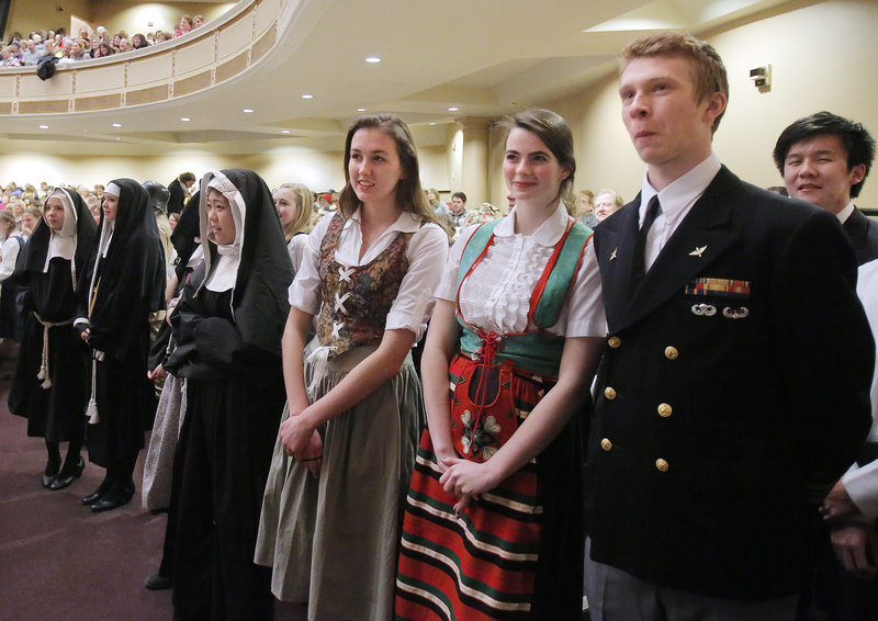 From right, Dainius Bukauskas, Grace Gilbert and Adela McVicar, all students at North Yarmouth Academy, wait to parade on stage at the start of the Sing-A-Long-A Sound of Music at Merrill Auditorium on Friday, February 1, 2013.