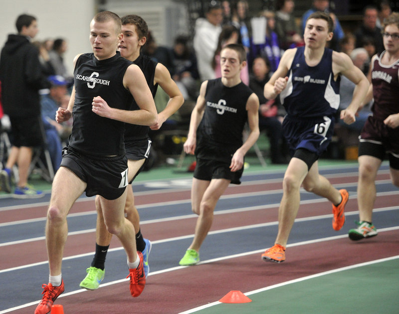 Robert Hall of Scarborough leads in the mile, and that's where he would stay, winning in 4 minutes, 40.1 seconds. Colin Tardiff and Will Fowler followed, giving the Red Storm a 1-2-3 finish in the event.