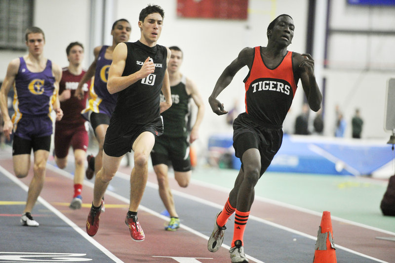 James Ociti, right, of Biddeford leads Greg Viola of Scarborough by a step midway through the 400. Ociti won the event by 1.22 seconds over Viola.