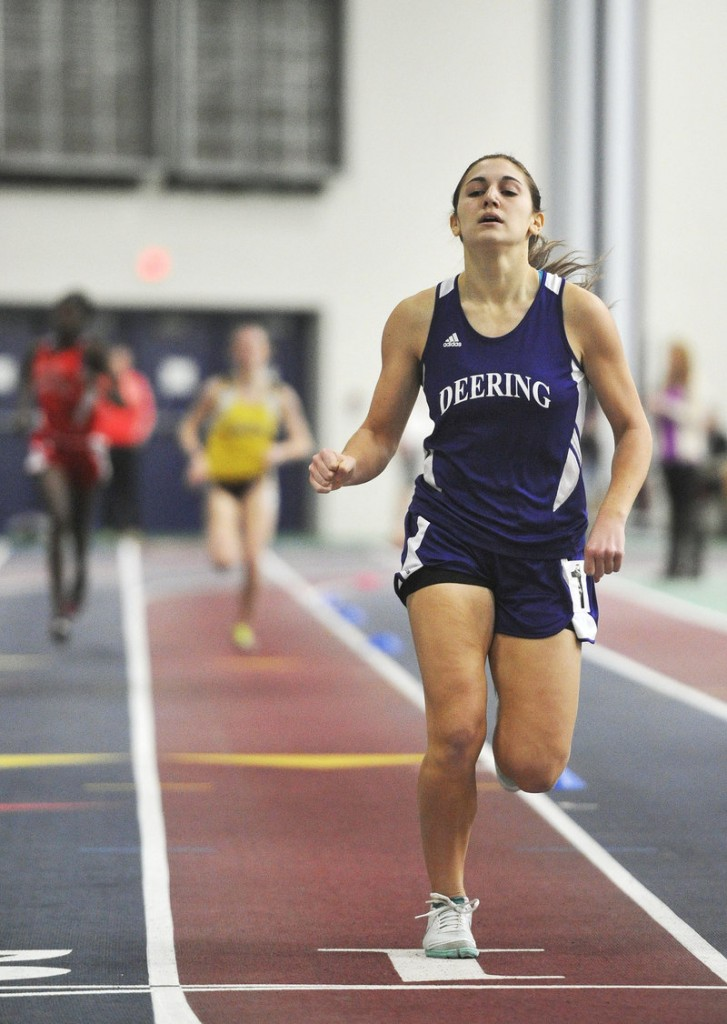 Edie Pallozzi of Deering crosses the finish line to set a record in the girls' 800 at the Southwesterns, capturing the event in 2 minutes, 19.5 seconds.