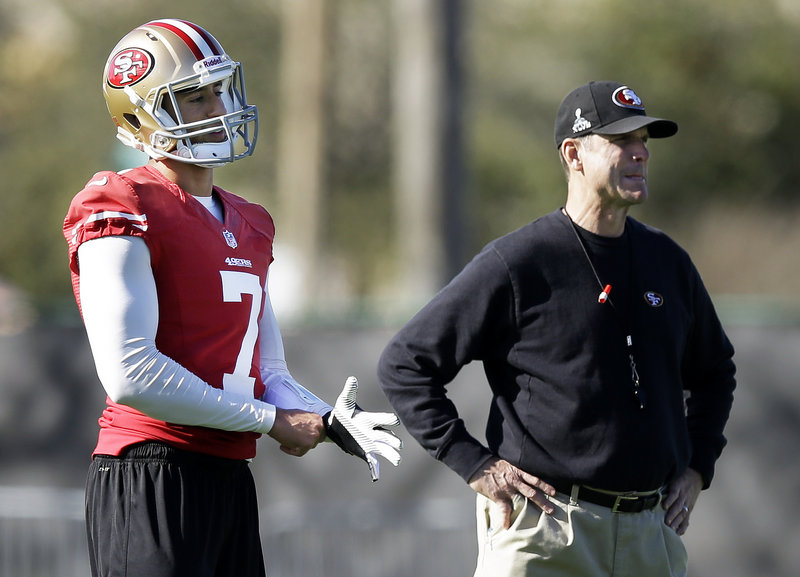 Colin Kaepernick has good reason to stand behind Coach Jim Harbaugh, who named him the 49ers' starting quarterback in November – a gamble that's paid off big time.