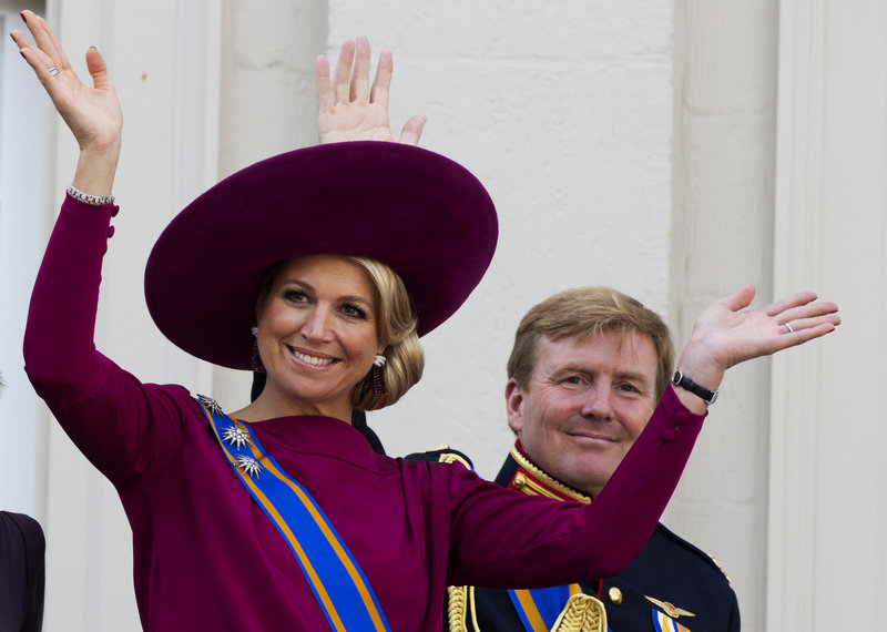 Princess Maxima and Crown Prince Willem Alexander wave to well wishers from the balcony of Royal Palace Noordeinde in The Hague, Netherlands, last Sept. 18. The couple will ascend to the Dutch thrones in April, but Maxima's father will not be present.