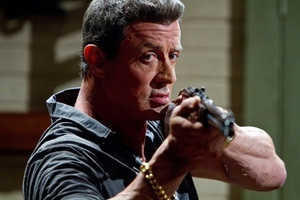 "Sylvester Stallone brandishes a gun in ""Bullet to the Head,"" a movie reviewed in the Jan. 31 edition of GO. Several photos in the Jan. 31 GO portray actors wielding guns, notes a reader who believes that violent entertainment desensitizes people to real-life shootings."