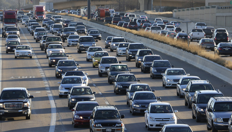 A new report finds that Americans wasted an average of $818 each sitting in traffic in 2011. That also meant more carbon dioxide entering the atmosphere.
