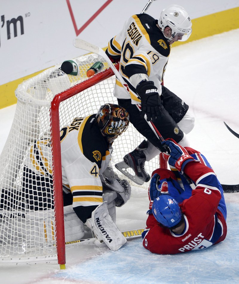 Brandon Prust of the Canadiens slides into Boston's Tyler Seguin and goalie Tuukka Rask Wednesday night.