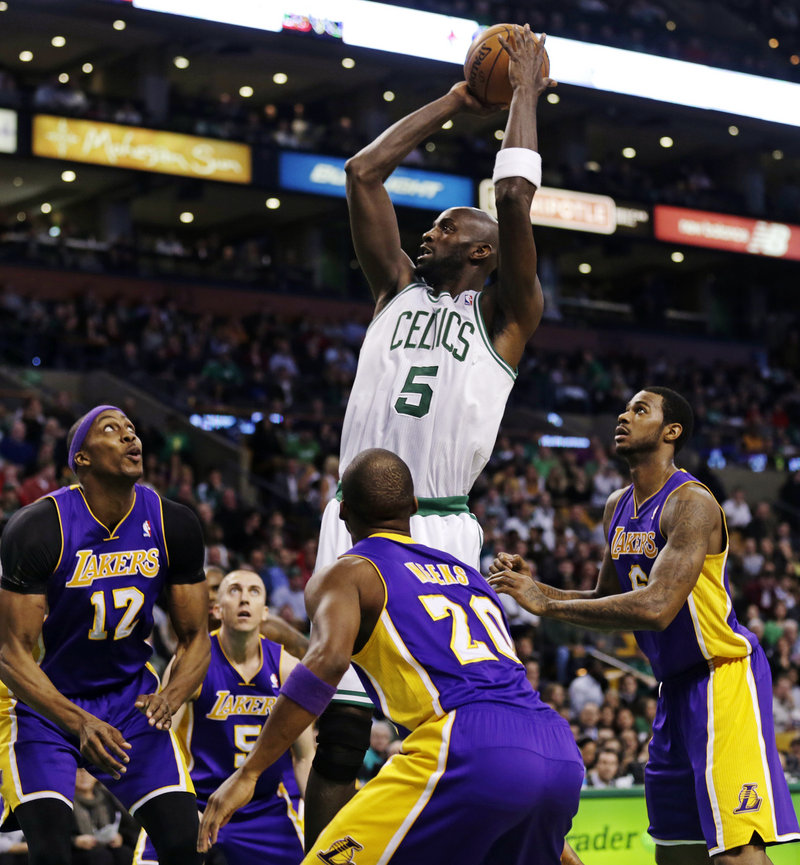 Celtics forward Kevin Garnett still finds a way to tower over his opponents, especially the Los Angeles Lakers, despite the season-ending loss of two valuable teammates.