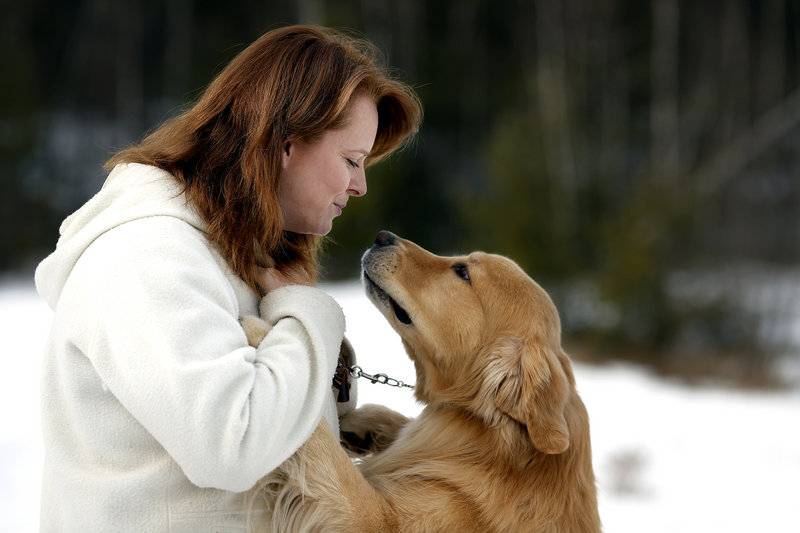 Patty Richards plays with Henry, her 5-year-old golden retriever, at her Jay home.