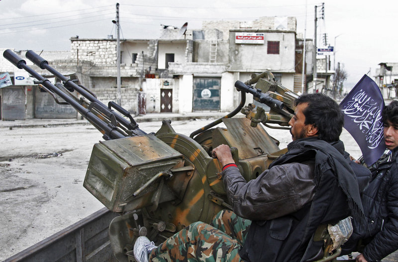 Free Syrian Army fighters sit behind their anti-aircraft weapon in Aleppo, Syria, on Friday, as rebels brought their fight within a mile of the heart of Damascus.