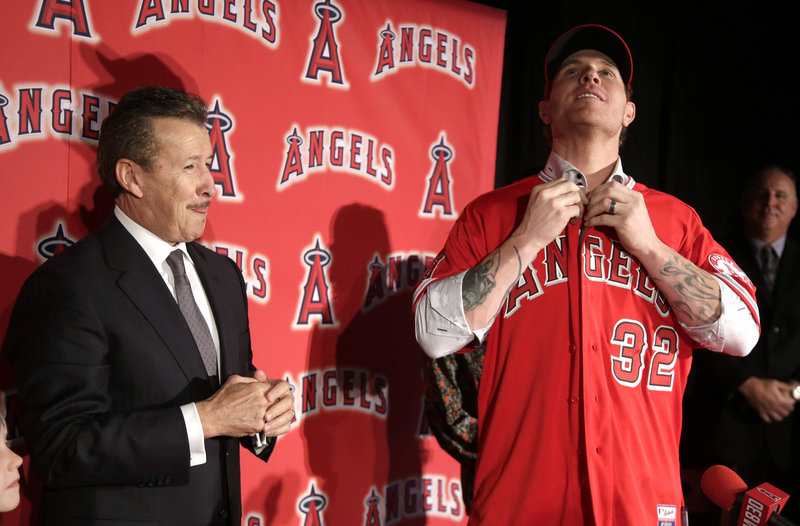 Josh Hamilton, right, was among several high-profile players who switched teams this offseason, moving from the Texas Rangers to their AL West rival, the Los Angeles Angels.