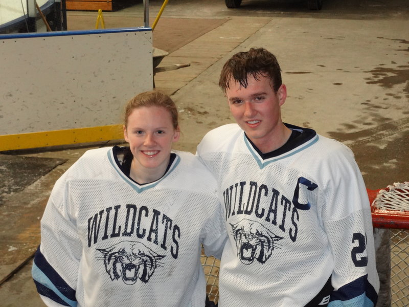 Freshman goalie Jillian Flynn, left, and her senior brother, Adam, are coached by their father, and their Presque Isle team appears headed to the Eastern Class B hockey tournament.