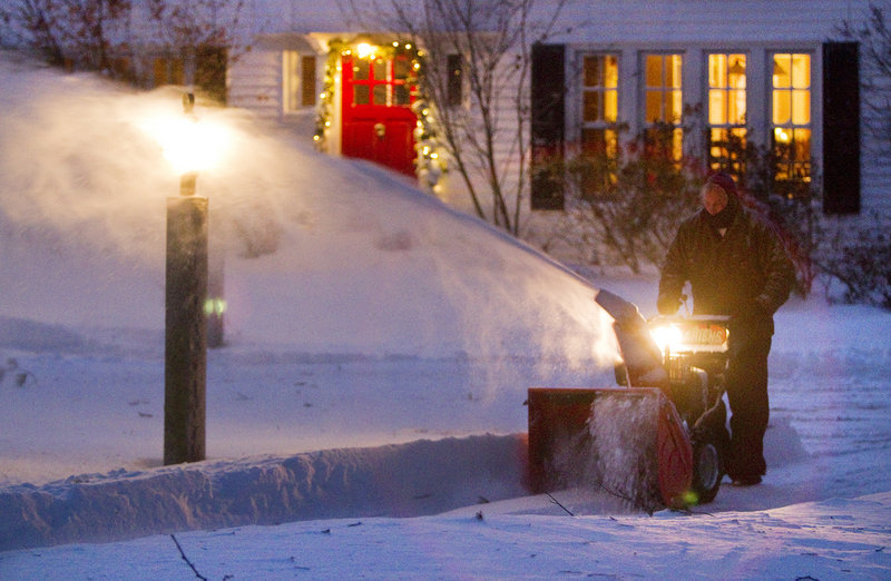 A homeowner on Foreside Road in Falmouth clears his driveway Saturday. Sunshine and temperatures in the high 20s to low 30s were expected Sunday, when the long, slow cleanup will continue.