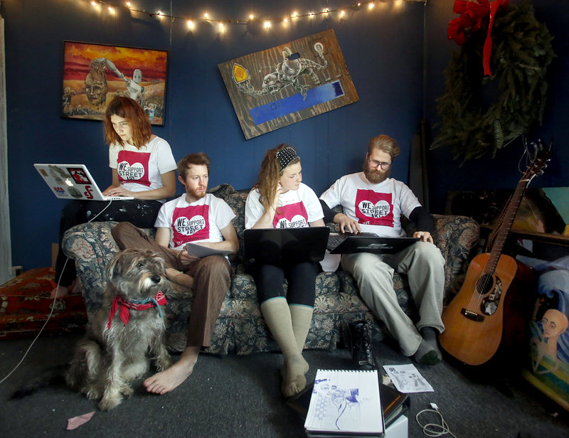 Members of the Creative Community Coalition, from left, Abbeth Russell, William Hessian, Marrion Ladd and Asher Platts work on their presentation Monday at Russell's and Hessian's home in Portland. On Tuesday a Portland City Council committee will review proposed new rules on street art vending.
