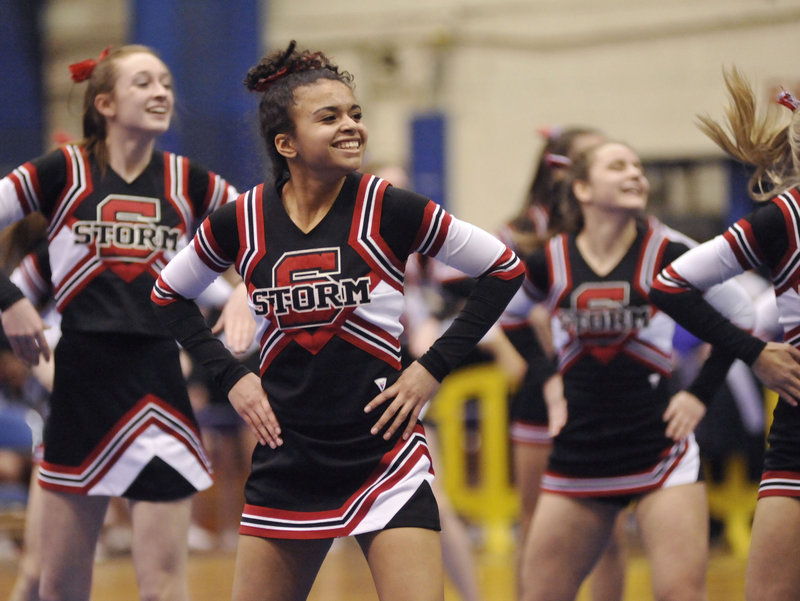 The Scarborough Red Storm cheerleaders, competing in Class A, perform during the state championships at the Bangor Auditorium on Monday. Lewiston won its third straight Class A title.