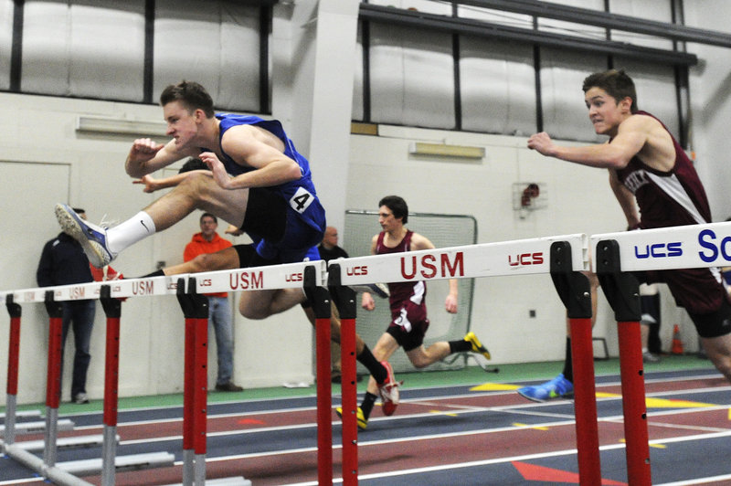 Tom Reid of York clears a hurdle on his way to victory in the 55-meter hurdles. Reid finished in 8.5 seconds.