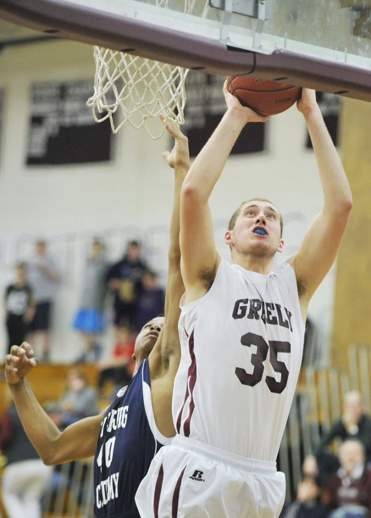 Greely's Michael McDevitt slips past Fryeburg's Jaquan Causer for two of his game-high 27 points during Tuesday's 71-51 victory.