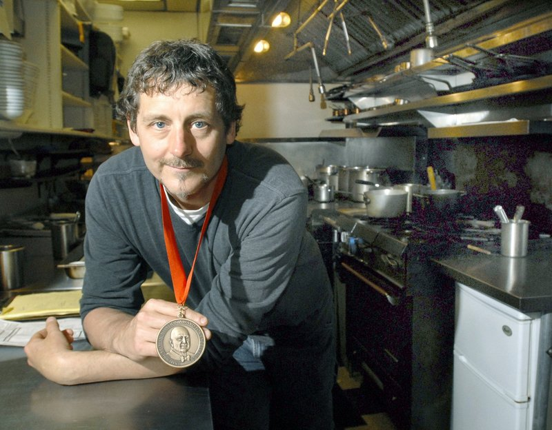 In this 2009 file photo, Portland chef Rob Evans of Duckfat with his James Beard Award. Evans made it all the way to the final two in the Food Network show