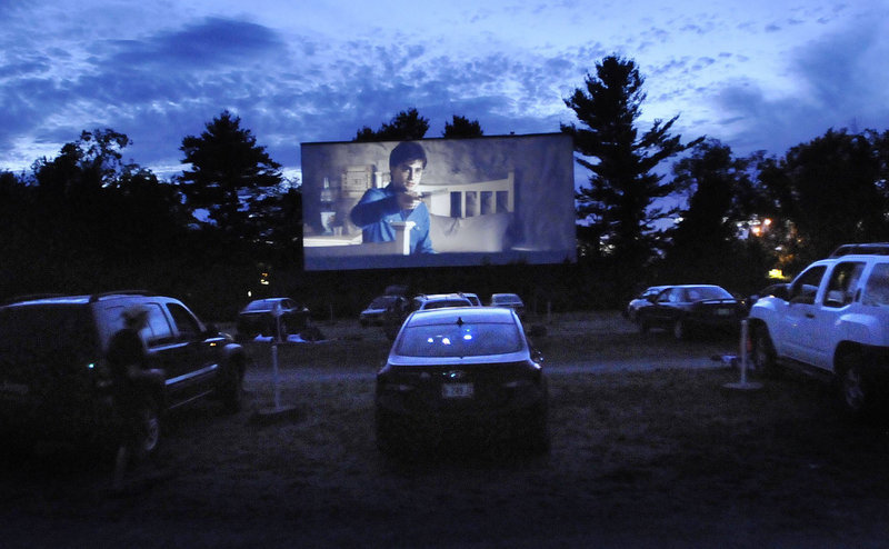 In this July 2011 file photo, cars are lined up to watch the latest Harry Potter movies at the Saco Drive-In. As movie studios move away from 35 mm film and firmly into the digital age, the nation's second-oldest drive-in theater faces the prospect of being left behind.