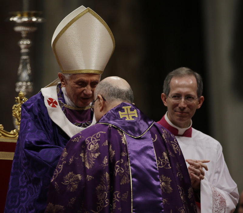 Vatican Secretary of State Cardinal Tarcisio Bertone greets Pope Benedict XVI at the end of the Ash Wednesday Mass in St. Peter's Basilica at the Vatican.