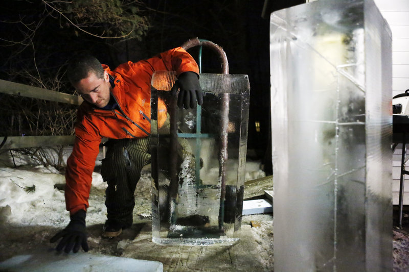 Ice sculptor Jesse Bouchard reaches for a piece of foam to put behind a block of ice on a handtruck that he will wheel back into his freezer at his South Portland home on Tuesday, February 12, 2013. The ice blocks will be made into an ice bar for the Hilton Garden Inn in Freeport on Friday night.