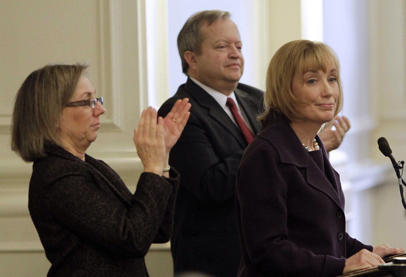 Speaker of the House Terie Norelli, left, and Senate President Peter Bragdon applaud Gov. Maggie Hassan, right., as she delivers her Budget Address at the Statehouse, Thursday, Feb. 14, 2013 in Concord, N.H. (AP Photo/Jim Cole)