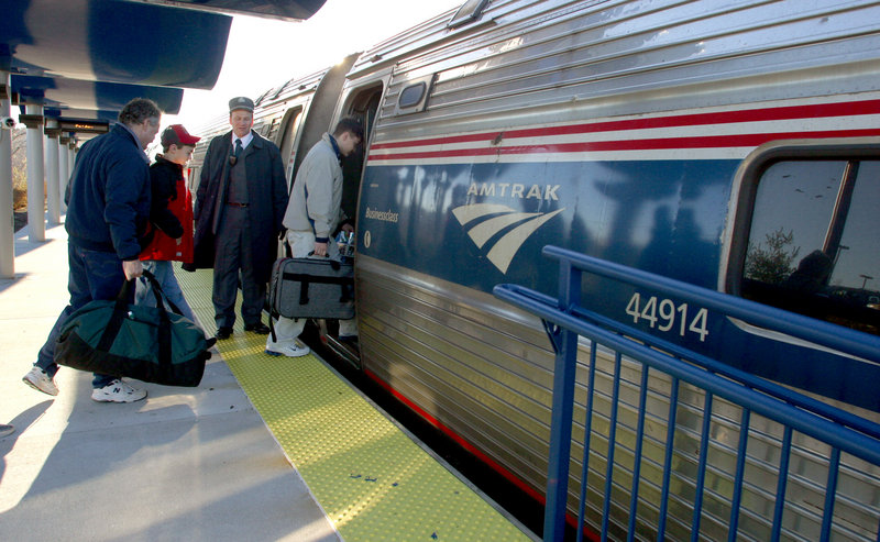 "Passengers board the Amtrak Downeaster in Portland in 2004. A reader takes issue with a state Department of Transportation prediction that ""a Lewiston/Auburn expansion would only carry an additional 30,000 riders."""