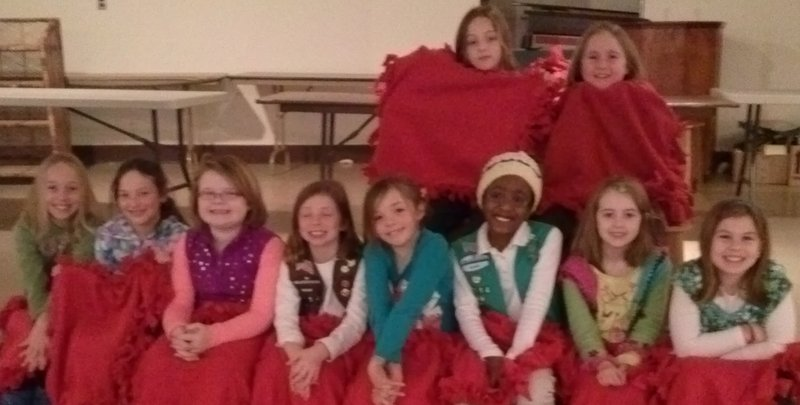Members of Girl Scout Troop 1714 of Portland pose with red fleece lap blankets they donated to the Teen Shelter in Portland on Valentine's Day. The girls adopted the shelter as one of their community service projects this year. At Thanksgiving, they donated boxes of food, and for Christmas they filled 16 stockings for the teenagers living at the center.