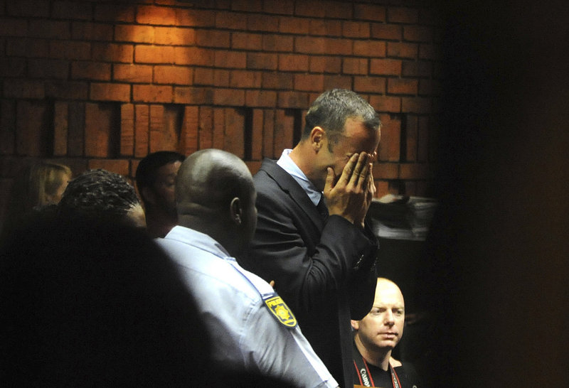 Double-amputee sprinter Oscar Pistorius weeps in court in Pretoria, South Africa, at his hearing Friday in the murder case of his girlfriend, Reeva Steenkamp.