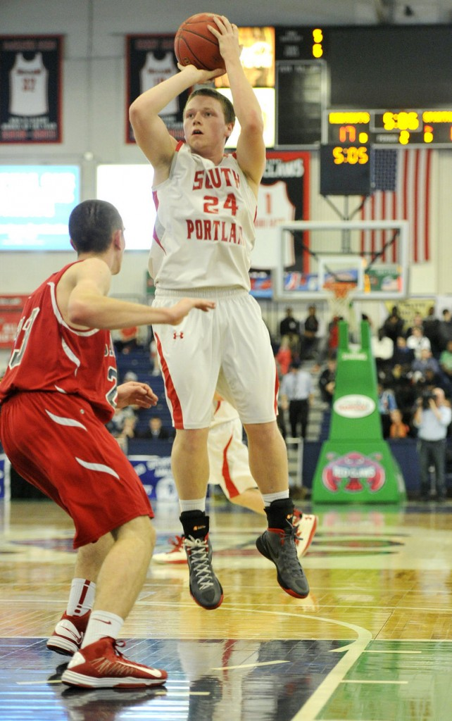 Conner MacVane of top-ranked South Portland gets enough room in the paint to take a shot over Brandon Stanton of ninth-seeded Sanford at the Portland Expo.