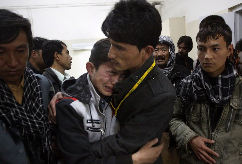 A Pakistani man comforts another mourning for a family member who died in a bomb blast in a Shiite Muslim-dominated suburb of the city of Quetta on Saturday.