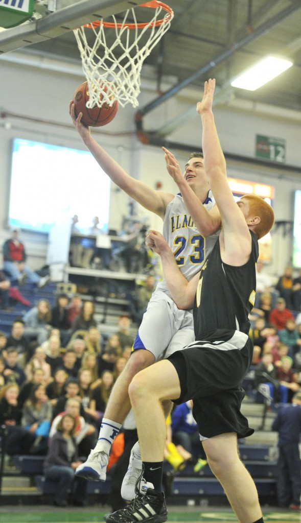Jack Simonds of Falmouth gets his layup swatted away by Kyle Boucher of Maranacook.