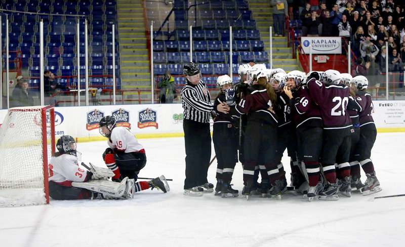 Game over, championship won, and as the Greely girls' hockey players celebrated, Riley McKeown and goalie Devan Kane of Scarborough knew a good fight had been in vain.