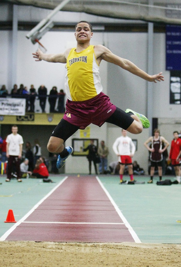 Andrew Smith of Thornton Academy gets plenty of air time while competing in the Class A long jump. Smith finished second with a jump of 20 feet, 4 inches.