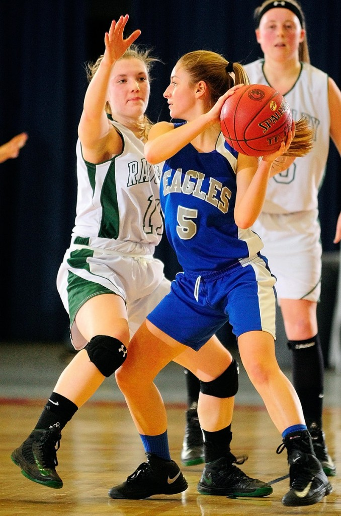 Ellie Snyder of Islesboro keeps the ball from Taylor Esty of Rangeley in Western Class D. Rangeley captured its quarterfinal, 52-28.