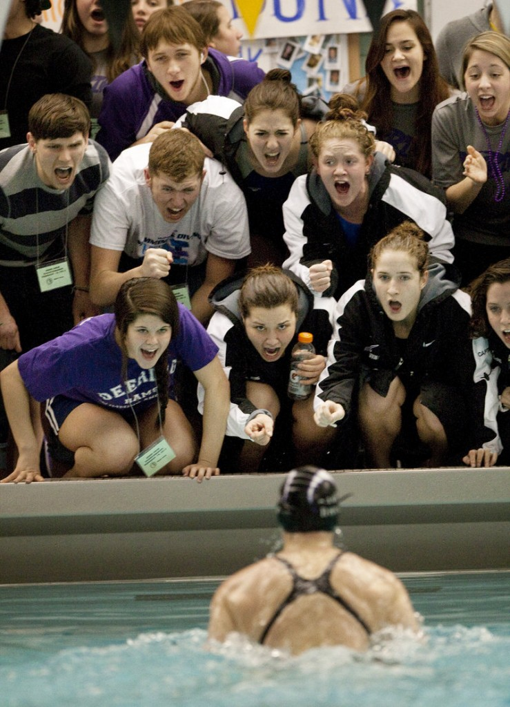 Genna Worthley is cheered on by her Deering High supporters. Worthley won the 200 individual medley and 100 breast stroke. She also was on the 200 medley relay team that placed second.