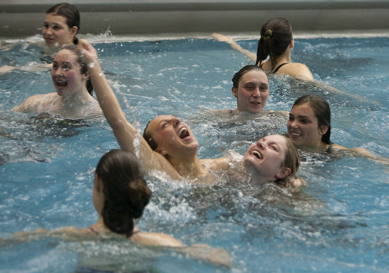 The Cape Elizabeth girls hold a team victory swim in the Bowdoin College pool in Brunswick after capturing the Class A state championship. Brunswick was second and Deering third, followed by Bangor and Cheverus.