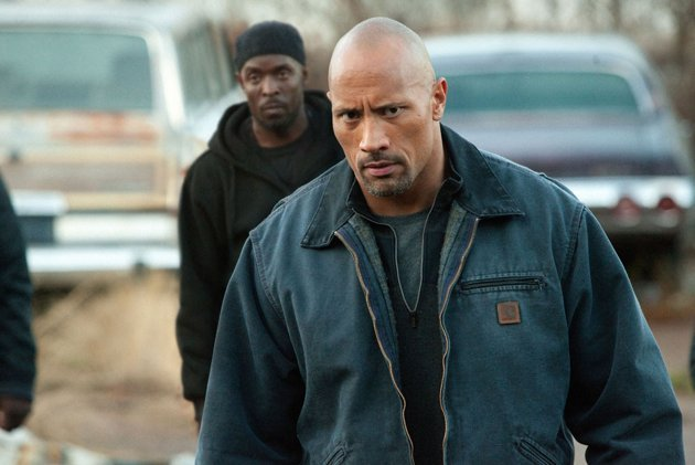 "Dwayne Johnson is a father who goes undercover for the DEA to free his son, who was imprisoned after being set up in a drug deal, in ""Snitch."""